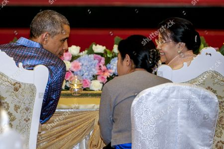 Us President Barack Obama (l) Talks to Myanmar President Thein Sein Wife Khin Khin Win (r) During the Gala Dinner at the Myanmar International Convention Centre For the 25th Association of South East Asian Nations (asean) Summit in the Administrative Capital of Naypyitaw Myanmar 12 November 2014 the Summit Runs From 09-13 November with Leaders From Ten Asean Member Countries and Its Dialogue Partners As Well As a Meeting of the East Asia Summit (eas) Involving Us President Barack Obama New Indonesian President Joko Widodo and Chinese Prime Minister Li Keqiang Among Others Myanmar Naypyitaw