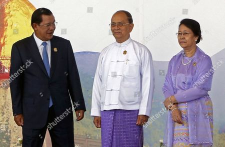 Cambodia Prime Minister Hun Sen (l) Talks to Myanmar President Thein Sein (c) and His Wife Khin Khin Win (r) After They Pose to Journalists During the 25th Association of South East Asian Nations (asean) Summit at the Myanmar International Convention Center in Naypyitaw Myanmar 12 November 2014 Myanmar Naypyitaw