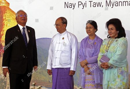 Malaysia Prime Minister Najib Razak and His Wife Talk to Myanmar President Thein Sein (2r) and His Wife Khin Khin Win (r) After They Pose to Journalists During the 25th Association of South East Asian Nations (asean) Summit at the Myanmar International Convention Center in Naypyitaw Myanmar 12 November 2014 Myanmar Naypyitaw