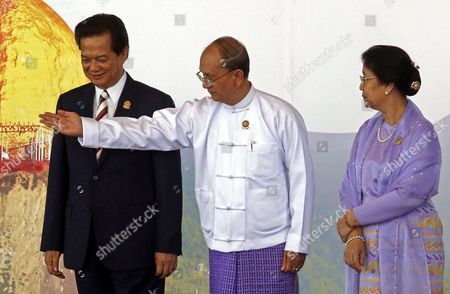 Vietnam Prime Minister Nguyen Tan Dung (l) Talks to Myanmar President Thein Sein (c) and His Wife Khin Khin Win (r) After They Pose to Journalists During the 25th Association of South East Asian Nations (asean) Summit at the Myanmar International Convention Center in Naypyitaw Myanmar 12 November 2014 Myanmar Naypyitaw