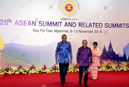 Stock Image of Myanmar President Thein Sein (2- L) with His Wife Khin Khin Win (r) Lead Us President Barack Obama (l) Into the Gala Banquet the 25th Association of South East Asian Nations (asean) Summit at the Myanmar International Convention Center in Naypyitaw Myanmar 12 November 2014 South-east Asian Leaders Gathered in Myanmar's Capital Naypyidaw on 12 November For the Bi-annual Asean Summit with the Focus Expected to Be on Economic Ties and Regional Territorial Disputes the Final Provisions of the Asean Economic Community - Due to Be Completed in December 2015 - Will Be High on the Agenda of the Two-day Conference the 10 Member Countries Will Also Be Launching a Green Economy Initiative to Combat Global Warming Asean Comprises Brunei Indonesia Malaysia the Philippines Singapore Thailand Vietnam Cambodia Laos and Myanmar the Asean Meetings Will Also Include Leaders From South Korea Australia New Zealand and Russia Myanmar Naypyitaw