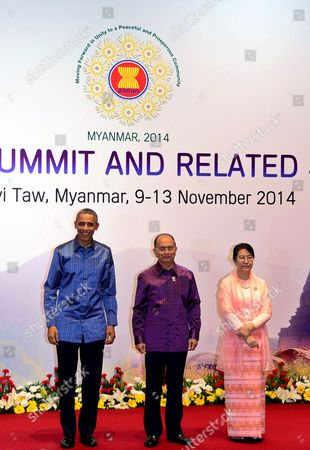 Stock Photo of Myanmar President Thein Sein (2- L) Standing with His Wife Khin Khin Win (2-r) Greet Us President Barack Obama (l) For the Gala Banquet at the 25th Association of South East Asian Nations (asean) Summit at the Myanmar International Convention Center in Naypyitaw Myanmar 12 November 2014 South-east Asian Leaders Gathered in Myanmar's Capital Naypyidaw on 12 November For the Bi-annual Asean Summit with the Focus Expected to Be on Economic Ties and Regional Territorial Disputes the Final Provisions of the Asean Economic Community - Due to Be Completed in December 2015 - Will Be High on the Agenda of the Two-day Conference the 10 Member Countries Will Also Be Launching a Green Economy Initiative to Combat Global Warming Asean Comprises Brunei Indonesia Malaysia the Philippines Singapore Thailand Vietnam Cambodia Laos and Myanmar the Asean Meetings Will Also Include Leaders From South Korea Australia New Zealand and Russia Myanmar Naypyitaw