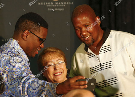 Stock Photo of Shaka Sisulu Grandson of Anti-apartheid Activist Walter Sisulu (l) Takes a Selfie with President of Chile Michelle Bachelet (c) and Mandla Mandela Grandson of Nelson Mandela (r) After Bachelet Gave the 12th Annual Nelson Mandela Lecture at the City Hall in Cape Town South Africa 09 August 2014 President Bachelet is the 12th Speaker at the Prestigeous Annual Nelson Mandela Lecture Series Hosted by the City of Cape Town and the Nelson Mandela Foundation South Africa Cape Town