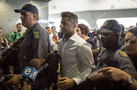 British Businessman Shrien Dewani (c) is Escorted by South African Police As He Makes His Way Through Cape Town International Airport Prior to His Departure From Cape Town to Dubai En Route to the Uk 09 December 2014 Judge Jeanette Traverso 08 December 2014 Dismissed the Case Against Shrien Dewani who was Accused of Masterminding the Murder of His Wife Anni During a Staged Car-jacking on Their 2010 Honeymoon South Africa Cape Town