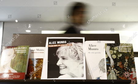 A Man Walks Behind a Display of Books by Canadian Author Alice Munro at a Book Store in Madrid Spain 10 October 2013 82-year-old Canadian Author Alice Munro Has Been Awarded the 2013 Nobel Prize For Literature Spain Madrid