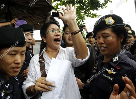Phayaw Akkahad (c) Mother of a Thai Nurse who was Shot Dead Inside a Buddhist Temple During a Military Crackdown on Red Shirt Protesters in 2010 is Arrested by Female Police Officers During a Demonstration in Bangkok Thailand 31 August 2014 at Least Three People Were Arrested During a Demonstration After a Thai Criminal Court Dropped the Murder Cases Against Former Prime Minister Abhisit Vejjajiva and His Deputy Suthep Thaugsuban For Authorizing a Crackdown on Anti-government Protesters in 2010 Thailand is Now Under Martial Law Which Prohibits All Political Gatherings of More Than Five People Thailand Bangkok
