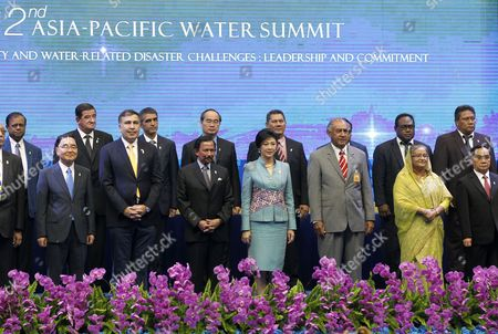 Stock Picture of (l-r Front Row) South Korea Prime Minister Chung Hong-won Georgia President Mikheil Saakashvili Brunei's Sultan Hassanal Bolkiah Thailand Prime Minister Yingluck Shinawatra Fiji President Ratu Epeli Nailatikau Bangladesh Prime Minister Sheikh Hasina and Laos Prime Minister Thongsing Thammavong Pose For a Group Photo During an Opening Ceremony of the Second Asia-pacific Water Summit in Chiang Mai Northern Thailand 20 May 2013 Thousands of Water Experts Engineers Political Leaders and High Ranking Officials From 50 Countries Attend the Second Asia-pacific Water Summit to Share Information and Discuss Water Management Water Security and Water Related Disasters Challenges Which Have Become a Global Major Concern Thailand Chiang Mai