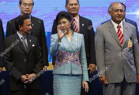 Stock Picture of Thailand Prime Minister Yingluck Shinawatra (c) Chats with Sultan of Brunei Hassanal Bolkiah (l) and Fiji President Ratu Epeli Nailatikau (r) During the Opening Ceremony of the Second Asia-pacific Water Summit in Chiang Mai Province Northern Thailand 20 May 2013 Thousands of Water Experts Engineers Political Leaders and High Ranking Officials From 50 Countries Attend the Second Asia-pacific Water Summit to Share Information and Discuss on Water Management Water Security and Water Related Disasters Challenges Which Have Become a Global Major Concern Thailand Chiang Mai