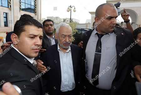 Leader of the Islamist Ennahda Party Rached Ghannouchi (c) Arrives For a Meeting of the National Dialogue Aimed at Ending the Ongoing Political Standoff in Tunis Tunisia 02 November 2013 Participants at the National Dialogue Are Continuing Their Discussions to Choose a New Premier to Replace Outgoing Ali Laarayedh the Ruling Ennahda Party Had Accepted a Plan Under Which Its Members Would Step Aside in Favor of a Transitional Government Composed of Politically Non-aligned Experts Tunisia Tunis