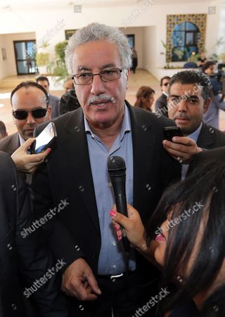 Tunisian Leader of Popular Front Party Hamma Hammami Speaks to Reporters on the Sidelines of the National Dialogue Aimed at Ending the Ongoing Political Standoff in Tunis Tunisia 04 November 2013 Participants at the National Dialogue Are Continuing Their Discussions to Choose a New Premier to Replace Outgoing Ali Laarayedh the Ruling Ennahda Party Had Accepted a Plan Under Which Its Members Would Step Aside in Favor of a Transitional Government Composed of Politically Non-aligned Experts Tunisia Tunis