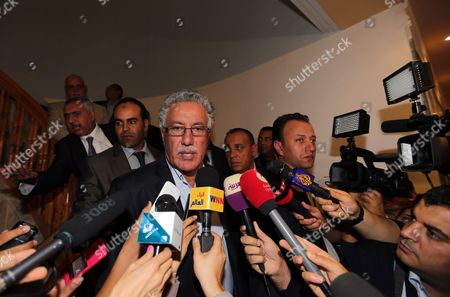 Tunisian Leader of Popular Front Party Hamma Hammami Speaks to Media on the Sidelines of a National Dialogue Aimed at Ending the Ongoing Political Standoff in Tunis Tunisia 02 November 2013 Participants at the National Dialogue Are Continuing Their Discussions to Choose a New Premier to Replace Outgoing Ali Laarayedh the Ruling Ennahda Party Had Accepted a Plan Under Which Its Members Would Step Aside in Favor of a Transitional Government Composed of Politically Non-aligned Experts Tunisia Tunis
