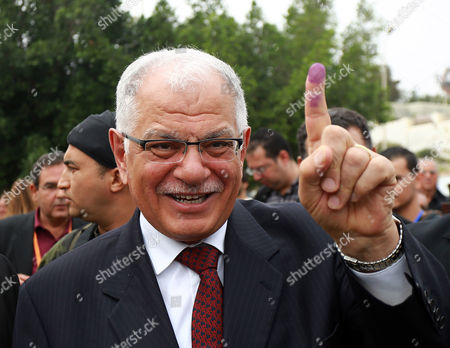 Former Tunisian Foreign Minister and Presidential Candidate Kamel Morjane Shows His Ink- Marked Finger After Casting His Ballot During Voting in the Tunisian Presidential Elections at a Polling Station in Sousse South of Tunis Tunisia 23 November 2014 Tunisians Are Voting in the Country's First Such Polls Since the Overthrow of Longtime Dictator Zine El Abidine Ben Ali in the 2011 Uprising Tunisia Tunis