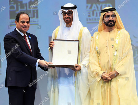 Sheikh Mohammad Bin Rashid Al-maktoum (r) Vice President and Prime Minister of Uae Stands by As Mohammad Bin Zayed Bin Sultan Al-nahyan (c) Crown Prince of Abu Dhabi and Deputy Supreme Commander of the Uae Armed Forces Presents the Egyptian President Abdel Fattah Al-sisi (r) with an Award During the Zayed Future Energy Prize Awards at the the World Future Energy Summit 2015 (wfes) in Abu Dhabi United Arab Emirates 19 January 2015 Global Leaders in Policy Technology and Business Are Gathering to Discuss and Develop New Ways of Thinking and Shaping the Future of Renewable Energy at the Summit Running From 19 - 22 January at the Abud Dhabi National Exhibition Center United Arab Emirates Abu Dhabi