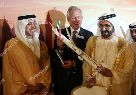Uae Vice President and Ruler of Dubai Sheikh Mohammed Bin Rashid Al Maktoum (r) Holds a Model of Emirates Airlines New 777x Aircraft with the Chairman and Ceo of the Boeing Company James Mcnerney (c) and Uae Deputy Prime Minister and Minister of Presidential Affairs Sheikh Mansour Bin Zayed Al Nahyan (l) During the Dubai Air Show 2013 at Dubai World Central - Al Maktoum International Airport in Jebel Ali Dubai United Arab Emirates 17 November 2013 Dubai Airline Emirates on 17 November Announced what It Said was the World's Largest-ever Aircraft Order Signing Deals For 150 Boeing 777x Aeroplanes As Well As 50 Airbus A380s the Company Owned by the Emirate of Dubai Will Pay 76 Billion Dollars For the Boeing Aircraft and 23 Billion Dollars For the Airbuses It Said United Arab Emirates Dubai
