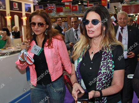 Egyptian Actresses Yousra (r) and Nelly Karim (l) Tour at Egyptian Section at Arabian Travel Market Exhibition and Dubai Airport Show in Gulf Emirate of Dubai United Arab Emirates 07 May 2013 Hosted at the Dubai International Convention and Exhibition Center the Show Brings Together More Than 7 348 Exhibiting Companies and Serves As a Platform For a Study on the Latest Trends From the Industry United Arab Emirates Dubai