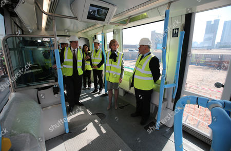 French Minister For Foreign Trade Nicole Bricq(2-r) Inspects Al Sufouh Tramway Which is Constructed by a Consortium of Alstom Besix and Parsons in Dubai United Arab Emirates 21 January 2014 Bricq is Visiting the Uae to Attend the World Future Energy Summit at Abu Dhabi Sustainability Week Al Sufouh Tramway is a 14 5 Kilometers Tramway That is Going to Run Along Al Sufouh Road From Dubai Marina to the Burj Al Arab and the Mall of the Emirates United Arab Emirates Dubai