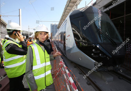 Stock Picture of French Minister For Foreign Trade Nicole Bricq (r) Inspects Al Sufouh Tramway Which is Constructed by a Consortium of Alstom Besix and Parsons in Dubai United Arab Emirates 21 January 2014 Bricq is Visiting the Uae to Attend the World Future Energy Summit at Abu Dhabi Sustainability Week Al Sufouh Tramway is a 14 5 Kilometers Tramway That is Going to Run Along Al Sufouh Road From Dubai Marina to the Burj Al Arab and the Mall of the Emirates United Arab Emirates Dubai