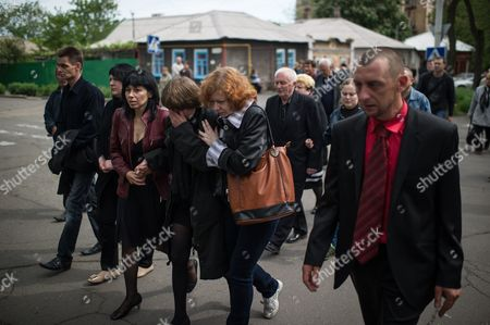 Close Relatives of Alexey Vorobyov a Man Killed During Deadly Clashes in Mariupol on 09 May Mourn During His Funeral Ceremony in Mariupol Ukraine 12 May 2014 Residents of Mariupol Voted on 11 May in an Independence Referendum That was Organized by Pro-russian Separatists and Rejected by the Government in Kiev Russian-speakers and Supporters of Moscow Have Been Rallying in the Region Since March when a Referendum on Independence Led to Russia's Annexation of Crimea Ukraine Mariupol