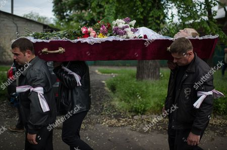Men Carry the Coffin with Alexey Vorobyov a Man Killed During Deadly Clashes in Mariupol on 09 May Mourn During His Funeral Ceremony in Mariupol Ukraine 12 May 2014 Residents of Mariupol Voted on 11 May in an Independence Referendum That was Organized by Pro-russian Separatists and Rejected by the Government in Kiev Russian-speakers and Supporters of Moscow Have Been Rallying in the Region Since March when a Referendum on Independence Led to Russia's Annexation of Crimea Ukraine Mariupol