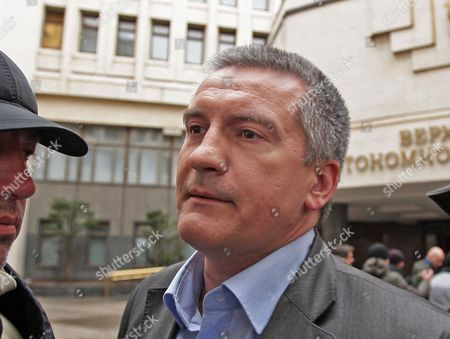 New Elected Crimea's Prime Minister Sergey Aksyonov was Seen Near of Parliament Building in Simferopol Crimea Ukraine 28 February 2014 the Armed Men Described by Interior Minister Arsen Avakov As Russian Naval Forces Took Control at 28 February of the Airports in Simferopol and Near the Port of Sevastapol where the Russian Black Sea Fleet Has a Base Russia Ratcheted Up the Tension in the Ukraine Crisis on 01 March with Its Upper House of Parliament Approving the Use of Armed Forces in the Crimean Peninsula Which is Part of Ukraine Russian President Vladimir Putin Asked the Federation Council to Approve the Use of Armed Forces in the Crimea Interfax News Agency Reported 'Until the Normalization of the Socio-political Situation in That Country ' Russian Lawmakers Had Urged Putin to Take Measures to Stabilize the Situation in Crimea and Protect the Russian-majority Population Ukraine Simferopol