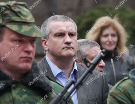 Crimea's Regional Leader Sergey Aksyonov (c) Arrives For a Swearing-in Ceremony Crimean Self Defense Soldiers in Simferopol Crimea Ukraine 08 March 2014 the Usa and European Union Have Threatened Sanctions Against Moscow Over the Military Standoff in the Strategic Crimean Peninsula and Are Urging Russia to Pull Back Its Forces in the Region and Allow in International Observers and Human Rights Monitors Crimea Which Has a Majority Ethnic Russian Population is Strategically Important to Russia As the Home Port of Its Black Sea Fleet Epa/artur Shvarts Ukraine Simferopol