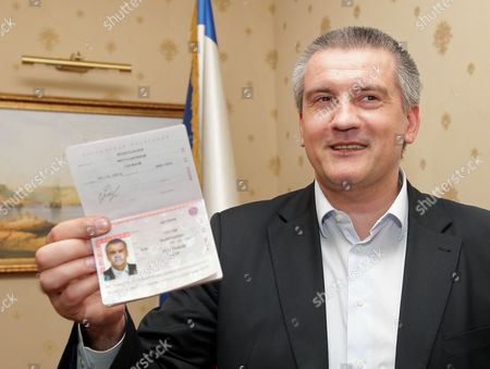 Crimean Premier Sergei Aksyonov Shows His Just Received Russian Passport in Simferopol Ukraine 20 March 2014 Russian President Putin on 18 March 2014 Signed a Treaty with the Moscow-backed Leaders of Crimea and Sevastopol About the Two Regions' Accession to Russia Ukraine Simferopol