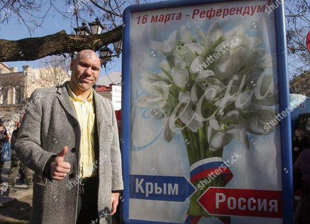 Russian Parliament Deputy Nikolai Valuev a Former Professional Heavyweight Boxer Thumbs Up Next to a Banner That Promotes the Crimean Referendum in the City of Simferopol Crimea Ukraine 13 March 2014 Crimean Authorities Intend to Hold a Referendum on 16 March when Residents Will Be Asked if They Want to Split From Ukraine the Ukrainian Government Denounced the Referendum As Illegal the Banner Reads: ''march 16 -referendum / Spring / Crimea - Russia' Depicting a Bunch of Local Spring Flowers Ukraine Simferopol