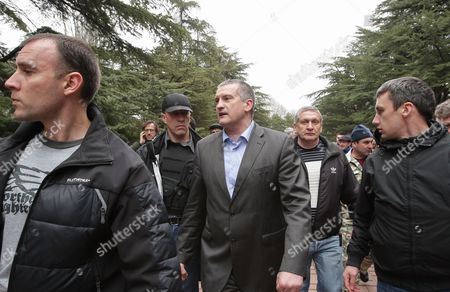 Crimea's Regional Leader Sergey Aksyonov (c) Qarrives For a Swearing-in Ceremony of Crimean Self Defense Units in Simferopol Ukraine Crimea 08 March 2014 the Usa and European Union Have Threatened Sanctions Against Moscow Over the Military Standoff in the Strategic Crimean Peninsula and Are Urging Russia to Pull Back Its Forces in the Region and Allow in International Observers and Human Rights Monitors Crimea Which Has a Majority Ethnic Russian Population is Strategically Important to Russia As the Home Port of Its Black Sea Fleet Ukraine Simferopol