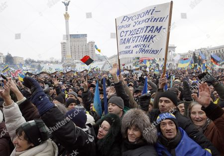 Ukrainian Pro-europe Protestors Shout Slogans As They Attend a Rally on the Independence Square in Kiev Ukraine 15 December 2013 As Ukrainian President Viktor Yanukovych and Leaders of Ukrainian Opposition Participated in a Round Table Event to Discuss Public Proposals Aimed at Achieving Political Stability Public Peace and Tranquility in Ukraine the Mass Demonstrations in Kiev Continued with Up to 20 000 Anti-government Protesters Reinforcing Barricades Emboldened by Police Assurances That They Would not Be Cleared by Force Ukraine Hopes to Continue Work on an Association Deal with the European Union a Spokesman For Prime Minister Nikolai Azarov Said 15 December Ukraine Would Only React to Official Eu Comments on the State of Negotiations He Told Russia's Interfax News Agency Indicating Ukraine was not Acknowledging a Sunday Tweet From the Eu's Neighbourhood Policy Commissioner Saying the Talks Were 'On Hold ' the Text on Banner Reads 'The Hero of Ukraine (award) - to Ruslana! a Monument to the Students at the Place where Lenin's Monument Was!' Ruslana is a Popular Ukrainian Singer and Activist Ukraine Kiev