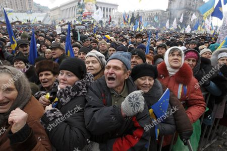 Ukrainian Pro-europe Protestors Shout Slogans As They Attend a Rally on the Independence Square in Kiev Ukraine 15 December 2013 As Ukrainian President Viktor Yanukovych and Leaders of Ukrainian Opposition Participated in a Round Table Event to Discuss Public Proposals Aimed at Achieving Political Stability Public Peace and Tranquility in Ukraine the Mass Demonstrations in Kiev Continued with Up to 20 000 Anti-government Protesters Reinforcing Barricades Emboldened by Police Assurances That They Would not Be Cleared by Force Ukraine Hopes to Continue Work on an Association Deal with the European Union a Spokesman For Prime Minister Nikolai Azarov Said 15 December Ukraine Would Only React to Official Eu Comments on the State of Negotiations He Told Russia's Interfax News Agency Indicating Ukraine was not Acknowledging a Sunday Tweet From the Eu's Neighbourhood Policy Commissioner Saying the Talks Were 'On Hold ' Ukraine Kiev