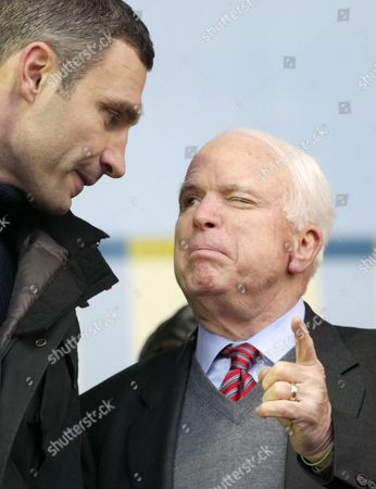 Us Senator John Mccain (r) Speaks with Ukrainian Opposition Leader Vitaly Klitschko (l) During a Pro-european Rally on the Independence Square in Kiev Ukraine 15 December 2013 As Ukrainian President Viktor Yanukovych and Leaders of Ukrainian Opposition Participated in a Round Table Event to Discuss Public Proposals Aimed at Achieving Political Stability Public Peace and Tranquility in Ukraine the Mass Demonstrations in Kiev Continued with Up to 20 000 Anti-government Protesters Reinforcing Barricades Emboldened by Police Assurances That They Would not Be Cleared by Force Ukraine Hopes to Continue Work on an Association Deal with the European Union a Spokesman For Prime Minister Nikolai Azarov Said 15 December Ukraine Would Only React to Official Eu Comments on the State of Negotiations He Told Russia's Interfax News Agency Indicating Ukraine was not Acknowledging a Sunday Tweet From the Eu's Neighbourhood Policy Commissioner Saying the Talks Were 'On Hold ' Epa/tatyana Zenkovich Ukraine Kiev