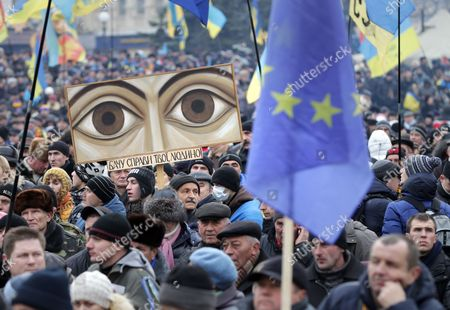 Ukrainian Pro-european Protestors Attend a Pro-europe Rally at the Independence Square in Kiev Ukraine 15 December 2013 As Ukrainian President Viktor Yanukovych and Leaders of Ukrainian Opposition Participated in a Round Table Event to Discuss Public Proposals Aimed at Achieving Political Stability Public Peace and Tranquility in Ukraine the Mass Demonstrations in Kiev Continued with Up to 20 000 Anti-government Protesters Reinforcing Barricades Emboldened by Police Assurances That They Would not Be Cleared by Force Ukraine Hopes to Continue Work on an Association Deal with the European Union a Spokesman For Prime Minister Nikolai Azarov Said 15 December Ukraine Would Only React to Official Eu Comments on the State of Negotiations He Told Russia's Interfax News Agency Indicating Ukraine was not Acknowledging a Sunday Tweet From the Eu's Neighbourhood Policy Commissioner Saying the Talks Were 'On Hold ' Ukraine Kiev