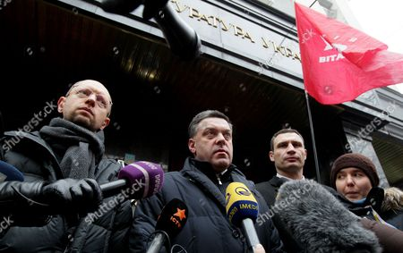 (l-r) Ukrainian Opposition Leaders Arseniy Yatsenyuk Oleg Tyagnibok and Vitali Klitschko Speak to the Media in Front of General Prosecutor's Office in Kiev Ukraine 16 December 2013 As Ukrainian President Viktor Yanukovych and Leaders of Ukrainian Opposition Participated in a Round Table Event to Discuss Public Proposals Aimed at Achieving Political Stability Public Peace and Tranquility in Ukraine the Mass Demonstrations in Kiev Continued with Up to 20 000 Anti-government Protesters Reinforcing Barricades Emboldened by Police Assurances That They Would not Be Cleared by Force Ukraine Hopes to Continue Work on an Association Deal with the European Union a Spokesman For Prime Minister Nikolai Azarov Said 15 December an Eu Official Blamed Ukrainian Dissembling As He Announced That an Association Agreement with Ukraine was 'On Hold ' As Pro- and Anti-government Protesters Massed in Kiev Amid Questions About the Country's Future Ties to the West and Russia Ukraine Kiev