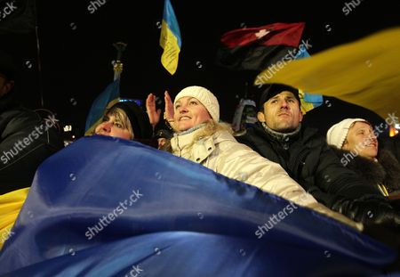 Ukrainian Anti-government Protestors Shout Slogans As They Attend a Rally on the Independence Square in Kiev Ukraine 15 December 2013 As Ukrainian President Viktor Yanukovych and Leaders of Ukrainian Opposition Participated in a Round Table Event to Discuss Public Proposals Aimed at Achieving Political Stability Public Peace and Tranquility in Ukraine the Mass Demonstrations in Kiev Continued with Up to 20 000 Anti-government Protesters Reinforcing Barricades Emboldened by Police Assurances That They Would not Be Cleared by Force Ukraine Hopes to Continue Work on an Association Deal with the European Union a Spokesman For Prime Minister Nikolai Azarov Said 15 December Ukraine Would Only React to Official Eu Comments on the State of Negotiations He Told Russia's Interfax News Agency Indicating Ukraine was not Acknowledging a Sunday Tweet From the Eu's Neighbourhood Policy Commissioner Saying the Talks Were 'On Hold ' Ukraine Kiev