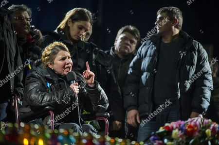 Ukrainian Opposition Leader Yulia Tymoshenko (l in Wheelchair) is Watched by Her Her Daughter Yevgenia (2-l Standing) and Other Unidentified Supporters As She Speaks to a Crowd at a Rally in Kiev Ukraine 22 February 2014 Former Ukrainian Prime Minister Yulia Tymoshenko on 22 February Appeared on the Stage of Kiev's Independence Square Or Maidan Hours After Being Released From Prison Tymoshenko who was in a Wheelchair First Praised the Protesters and Those who Were Killed During Last Week's Unrest 'The Heroes Never Die' She Said with a Tearful Voice the Square was Packed with Tens of Thousands of People the Former Ukrainian Prime Minister who was Sentenced to Seven Years in Jail For Abuse of Office in 2011 Earlier Said She Will Stand For President in May the Itar-tass News Agency Reported the Ukrainian Parliament on 22 February Set Early Presidential Elections For 25 May 2014 Ukraine Kiev
