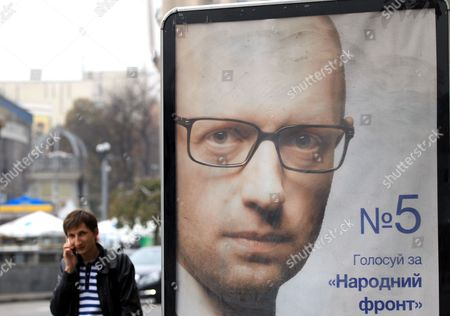 A Man Passes an Election Poster with a Portrait of Ukrainian Prime Minister Arseny Yatseniuk Leader of the People's Front Party in Kiev Ukraine 22 October 2014 Nadia Savchenko is an Officer of the Ukrainian Army who Fought As a Volunteer in the East of Ukraine in the Aidar Battalion and was Captured by Pro-russian Rebels the Parliamentary Elections Will to Be Held on 26 October 2014 Ukraine Kiev