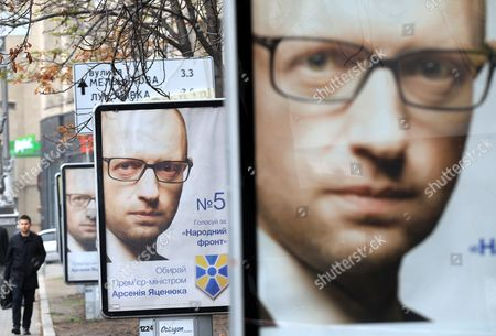 A Man Passes Election Posters with Portraits of Ukrainian Prime Minister Arseny Yatseniuk Leader of the People's Front Party in Kiev Ukraine 22 October 2014 Nadia Savchenko is an Officer of the Ukrainian Army who Fought As a Volunteer in the East of Ukraine in the Aidar Battalion and was Captured by Pro-russian Rebels the Parliamentary Elections Will to Be Held on 26 October 2014 Ukraine Kiev