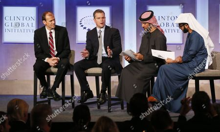 (l-r) Gary White Ceo and Co-founder Water Org Listens As Matt Damon Actor and Co-founder Makes a Plea to Support Clean Water During a Discussion Moderated by Mohammad Parham Al Awadhi and Peyman Parham Al Awadhi Co-founders Peeta Planet at the Clinton Global Initiative in New York Usa 23 September 2014 United States New York