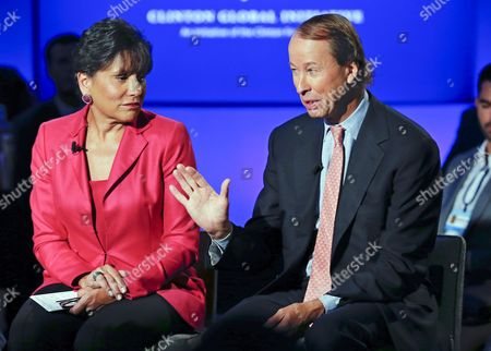 Stock Photo of Penny Pritzker U S Secretary of Commerce Listens to Tony James President and Coo Blackstone (r) As He Speaks During a Television Interview at the Clinton Global Initiative in New York Usa 23 September 2014 United States New York