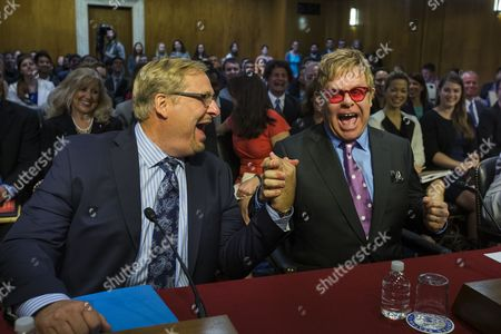 British Singer Elton John (r) Founder of the Elton John Aids Foundation Jokes with Rick Warren (l) Pastor of the Saddleback Church Before the Two Testified at a Senate Appropriations Committee Hearing on Global Health Issues in the Dirksen Senate Office Building in Washington Dc Usa 06 May 2015 United States Washington