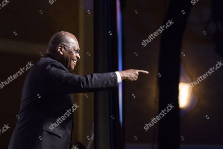 Former Presidential Candidate Herman Cain Gestures to the Crowd As He Arrives on Stage to Speak During the Faith and Freedom Coalition's 'Road to Majority' Conference in Washington Dc Usa 20 June 2014 the Three-day Conference Featured Many Potential 2016 Presidential Candidates who Are Courting the Audience United States Washington