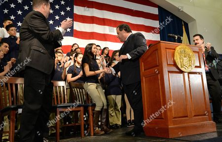 New Jersey Governor Chris Christie (c-r) Shakes Hands with Diana Paneque (c-l) an 11th Grade Honor Student From Union City High School Following a Ceremonial Signing of 'Dream Act' Legislation at Colin Powell Elementary School in Union City New Jersey Usa 07 January 2014 the Legislation Which was Official Signed by Christie Last Month Lowers Tuition Costs at Public Colleges For New Jersey Students who Do not Have Lawful Immigration Status United States Union City