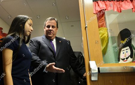 New Jersey Governor Chris Christie (r) Holds a Door For Diana Paneque (l) an 11th Grade Honor Student From Union City High School Before a Ceremonial Signing of the 'Dream Act' Legislation at Colin Powell Elementary School in Union City New Jersey Usa 07 January 2014 the Legislation Which was Official Signed by Christie Last Month Lowers Tuition Costs at Public Colleges For New Jersey Students who Do not Have Lawful Immigration Status United States Union City