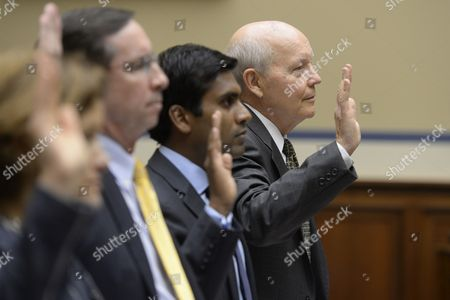 Internal Revenue Service (irs) Commissioner John Koskinen (r) is Sworn-in to Testify Along with Other Witnesses During the House Oversight and Government Reform Subcommittee Hearing on 'Examining Solutions to Close the 106 Billion U S Dollar Improper Payment Gap' on Capitol Hill in Washington Dc Usa 09 July 2014 Also in the Picture is Deputy Administrator and Director of the Center For Program Integrity at the Center For Medicare and Medicaid Service Shantanu Agrawal (2-r); and Mark Easton (3-r) Deputy Chief Financial Officer at the Us Defense Department United States Washington