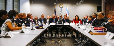 Stock Picture of Us Attorney General Eric Holder (head Table 2-l) Joins Chicago Mayor Rahm Emanuel (l) Us Attorney For the Northern District of Illinois Zachary T Fardon (2-r) and Cook County Illinois States Attorney Anita Alvarez (r) During a Meeting with Community Leader Law Enforcement Clergy and Political Leaders on Building Public Trust in the Everett Mckinley Dirksen Courthouse in Chicago Illinois Usa 12 December 2014 the Chicago Meeting is the Latest in a Series of Meetings in Five Locations Across the Country in the Wake of Recent Police Shootings of Unarmed Citizens and the Public's Reaction to Them United States Chicago