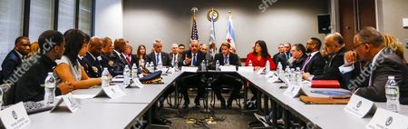 Stock Image of Us Attorney General Eric Holder (head Table 2-l) Joins Chicago Mayor Rahm Emanuel (l) Us Attorney For the Northern District of Illinois Zachary T Fardon (2-r) and Cook County Illinois States Attorney Anita Alvarez (r) During a Meeting with Community Leader Law Enforcement Clergy and Political Leaders on Building Public Trust in the Everett Mckinley Dirksen Courthouse in Chicago Illinois Usa 12 December 2014 the Chicago Meeting is the Latest in a Series of Meetings in Five Locations Across the Country in the Wake of Recent Police Shootings of Unarmed Citizens and the Public's Reaction to Them United States Chicago
