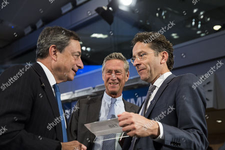 From Left Mario Draghi President of the European Central Bank Olivier Blanchard Chief Economist of the International Monetary Fund (imf) and Jeroen Dijsselbloem Dutch Finance Minister and President of the Eurogroup Speak with Each Other During a Meeting of the International Monetary and Financial Committee (imfc) at the International Monetary Fund (imf) and World Bank Group 2014 Annual Meetings in Washington Dc Usa 11 October 2014 United States Washington