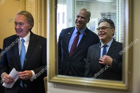 Democratic Senator From New Jersey Cory Booker (c) and Democratic Senator From Minnesota Al Franken (r) Are Reflected in a Mirror As Democratic Senator From Massachusetts Ed Markey (l) Arrives at a Press Conference where They All Spoke About the Senate's Consideration of Net Neutrality in the Us Capitol in Washington Dc Usa 04 February 2015 Earlier in the Day Federal Communications Commission Chairman Tom Wheeler Said in an Op-ed That He Wants Tight Net Neutrality Rules United States Washington