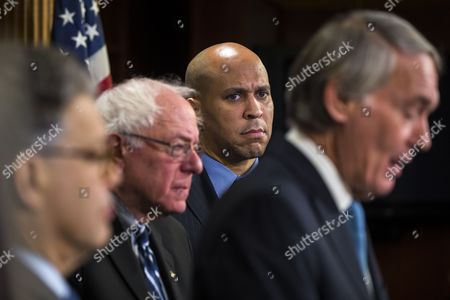 Democratic Senator From New Jersey Cory Booker (c-r) and Independent Senator From Vermont Bernie Sanders (c-l) Look on As Democratic Senator From Massachusetts Ed Markey (r) Speaks at a Press Conference About the Senate's Consideration of Net Neutrality in the Us Capitol in Washington Dc Usa 04 February 2015 Earlier in the Day Federal Communications Commission Chairman Tom Wheeler Said in an Op-ed That He Wants Tight Net Neutrality Rules United States Washington