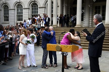 New York City Bill De Blasio (r) Looks on As Three Couples (l-r) Katrina Council and Sara Joseph Tom Kirdahy and Playwright Terrence Mcnally Cindy Jackson and Denice Niewinski Celebrate After Being Married During a Ceremony Outside of New York City Hall in New York New York Usa 26 June 2015 the Event During Which Two Couples Were Officially Married Along with the Reaffirming of Vows Celebrated Today's Ruling by the United States Supreme Court Which Legalized Gay Marriages Nationwide United States New York